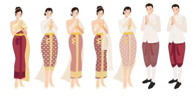 De thaise groet sawasdee van het huwelijkspaar in traditionele kleding