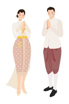 De thaise groet van het huwelijkspaar in room traditionele kleding