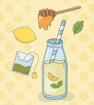 De theefles van de honing en van de citroen met stro