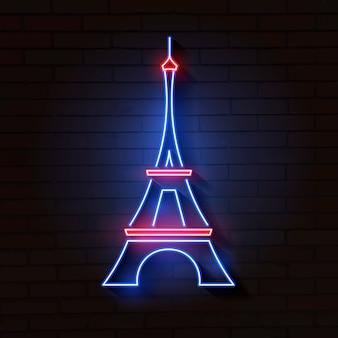 De toren van eiffel in neonlicht op baksteen