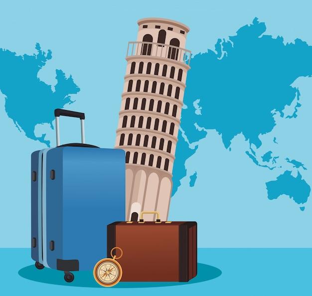De toren van pisa met kleurrijke reiskoffers en kompas