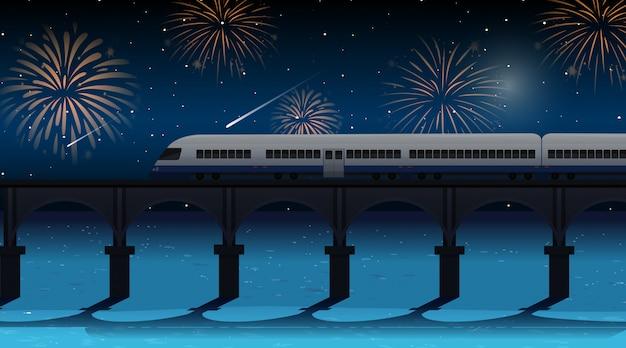 De trein steekt de rivier over met het vuurwerkscène van de viering