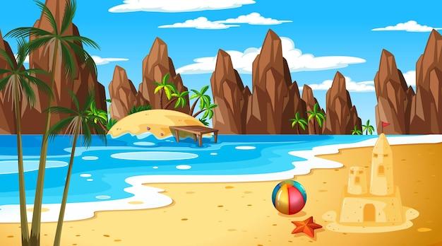 De tropische scène van het strandlandschap met zandkasteel