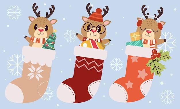 De verzameling schattige rendieren in de grote kerstsok