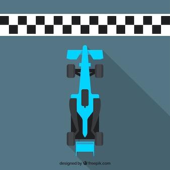 De vlakke blauwe f1 raceauto kruist voltooiingslijn