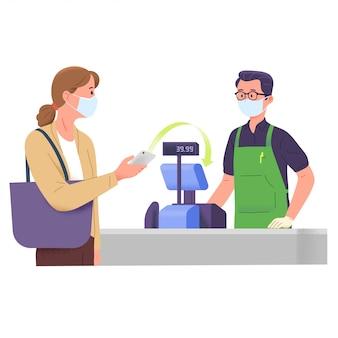 De vrouw betaalt kruidenierswinkel aan kassier met girale digitale betaling bij de uitbraak van viruscorona