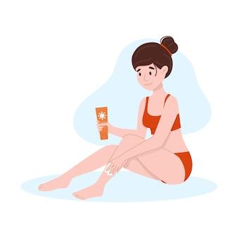 De vrouw is ingesmeerd met zonnebrandcrème selfcare