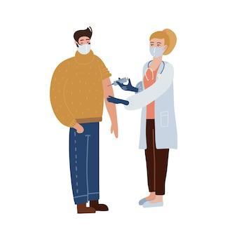 De vrouwelijke arts geeft een injectie met het anti covid-19-vaccin aan de mannelijke patiënt. tijd om je tegen ziekte te laten vaccineren.