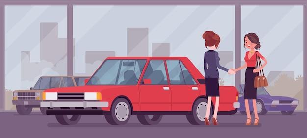 De vrouwelijke autodealer verkoopt een nieuwe rode auto aan de vrouw