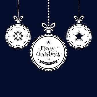De wensen van kerstmis siert gouden snuisterijen die blauwe achtergrond hangen
