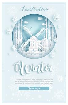 De winter in amsterdam voor reis en reis reclameconcept met wereldberoemd oriëntatiepunt