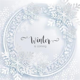 De winter komt eraan, formulering op winterkaart met sneeuwvlokkenframe in papierstijl