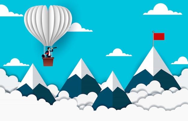 De zakenman die zich op ballon bevinden die met verrekijker kijken gaat naar rode vlag op hemel tussen berg