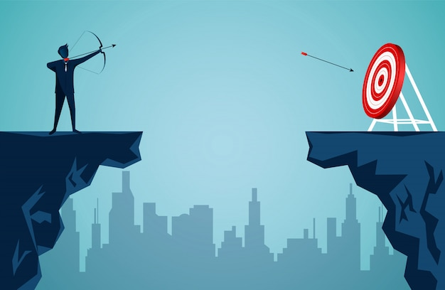 De zakenman die zich op klip bevindt schiet een pijl over de klip tegenover de pijl naar het doel in het midden van de rode cirkel
