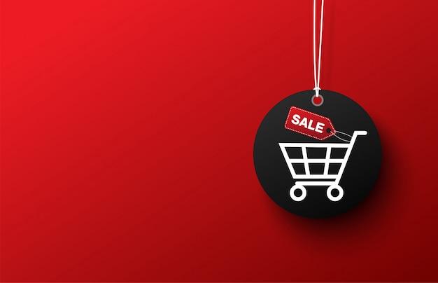 De zwarte verkoop van het etiketboodschappenwagentje op rode achtergrond