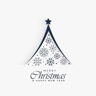 Decoratieve kerstboom gemaakt met sneeuwvlokken achtergrond
