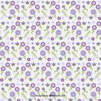 Decoratieve kleine paarse bloemen met bladeren patroon
