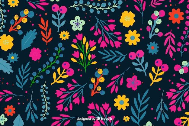 Decoratieve kleurrijke bloemen en bladerenachtergrond