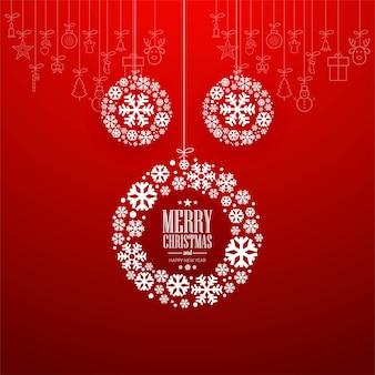 Decoratieve merry christmas-bal met rode achtergrond