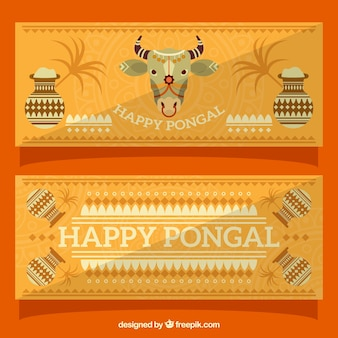 Decoratieve pongal banners met koe en potten