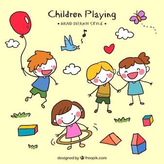 Decoratieve spelende kinderen in de hand getekende stijl