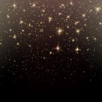 Deeltjes glitter van goud gloeiende magische glans en sterren stof donkere achtergrond.