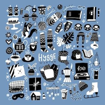 Deens lifestyle concept hygge-elementen stellen gezellige elementen in voor het winterseizoen gebreide kledingkaarsen ...