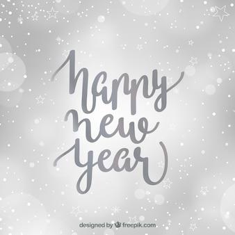 Defocused zilver gelukkig nieuwjaar achtergrond