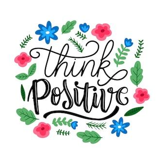 Denk aan positieve letters met bloemen