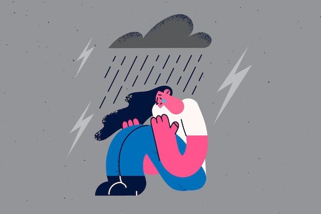 Depressie, verdriet en eenzaamheid concept. jonge trieste depressieve vrouw zittend op de grond huilend met regen en storm met donder boven vectorillustratie