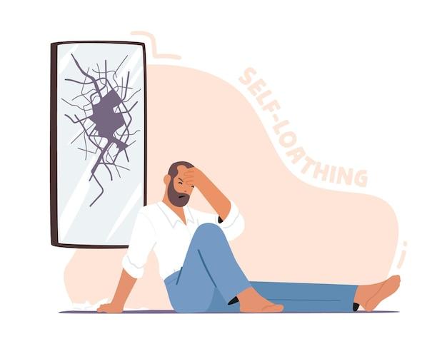 Depressieve ongelukkige man zittend op de vloer met gebroken hoofd in de buurt van gebarsten spiegel