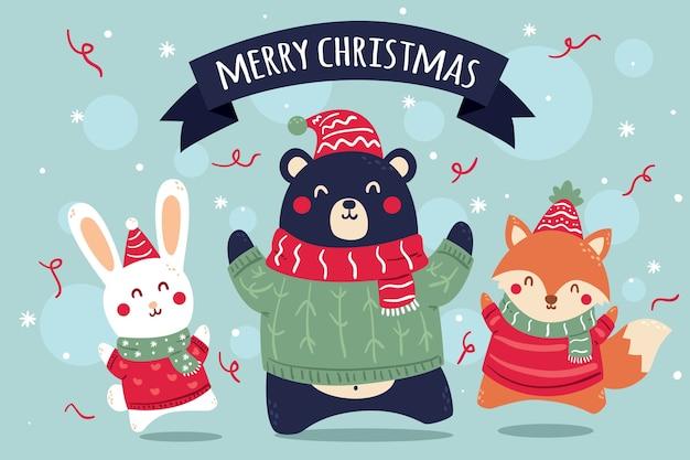 Dierlijke vrienden die van kerstmis genieten