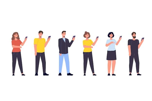 Diverse focusgroep van volkeren concept met smartphone in handen