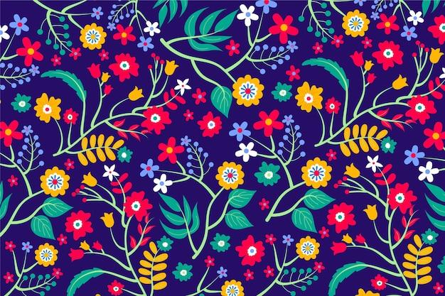 Diverse kleurrijke bloemen en bladerenachtergrond