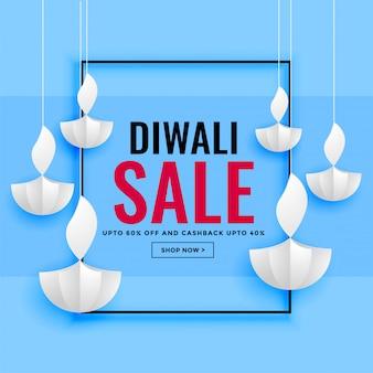Diwali verkoopbanner met document diya ontwerp