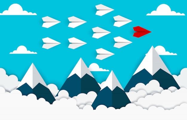 Document vliegtuig rode en witte vlieg op de hemel tussen wolk en berg
