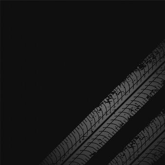 Donkere achtergrond met bandenprintmarkeringen