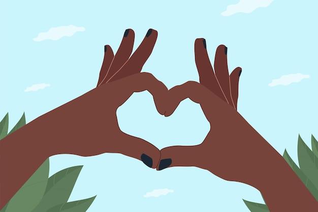 Donkere handen die een hart maken.