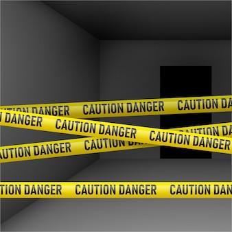 Donkere kamer met gevaar tape