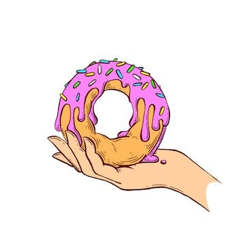 Donut in de hand.