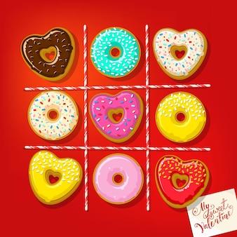 Donuts in de vorm van een hart met mijn zoete valentijnsnota op tafel.