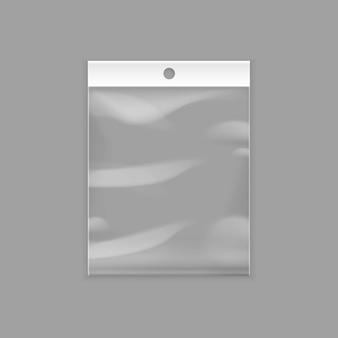 Doorzichtige plastic zakzak met ophangsleuf Premium Vector