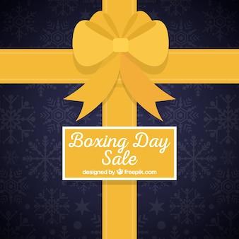 Doosdag achtergrond in de vorm van een cadeau doos met een geel lint