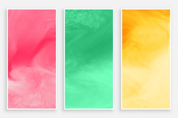 Drie aquarellenbanner in verschillende kleuren