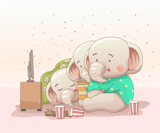 Drie babyolifanten die op film letten