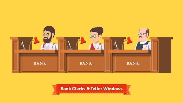 Drie bankbedienden op het werk