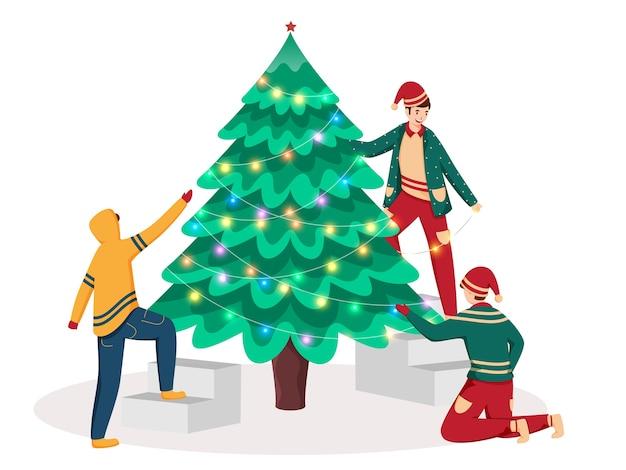 Drie cartoon jonge jongen versierde kerstboom