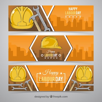Drie gele helm dag van de arbeid banners