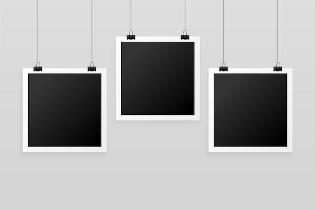 Drie hangende fotolijsten achtergrond