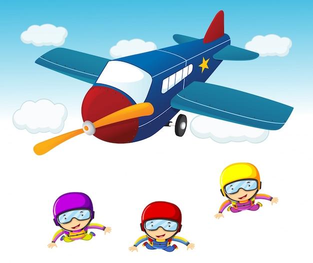 Drie hemelduikers die uit het vliegtuig springen
